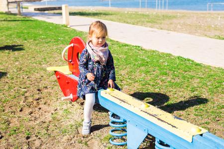 Active little girl on playground. Little child girl