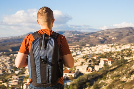 Man traveler with hat and backpack enjoying the natural surroundings.