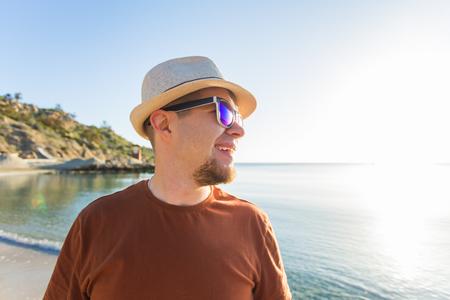 Man in sunglasses in seashore