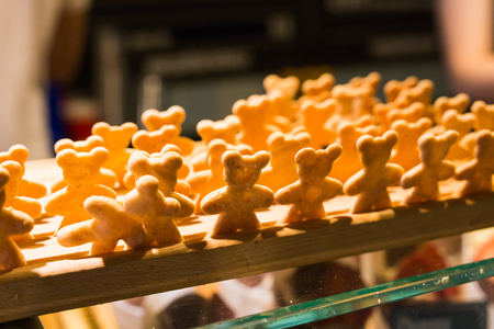 Lots of homemade little cookies in shape of bears in the bakery. Stock Photo