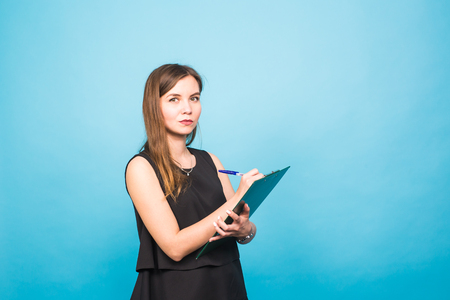 executive assistants: Business woman write on clipboard Stock Photo