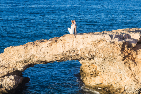 wedding in cyprus, bride and groom on a stone bridge in Agia Napa, cyprus Stock Photo