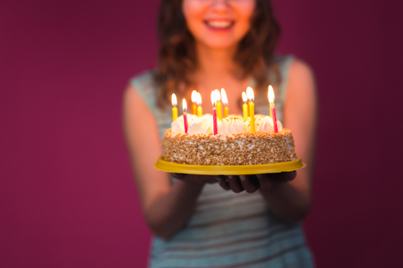 attractive teenage girl celebrating her birthday with cake. Stock Photo