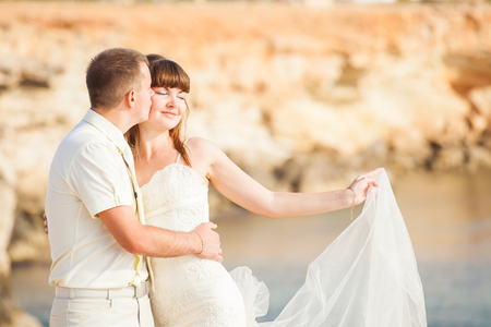 Portrait of happy bride and groom outdoor in nature location. Summer or autumn season. Stock Photo