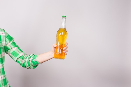 Beer bottle in the hand on white background. Stock Photo