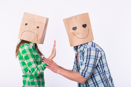 disappointed woman with bags over heads rejecting her boyfriend