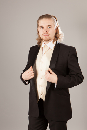Portrait of handsome young man in a tuxedo. Fashionable clothing for the festive evening Imagens