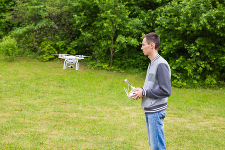 Ufa, Russia. - 6 June 2016 : Man Operating Drone Flying or Hovering by Remote Control in Nature Redakční
