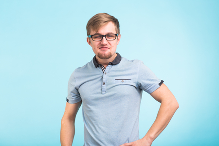 Arrogant bold self important stuck up man over blue background