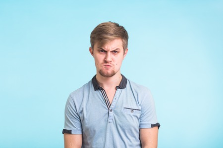 Funny angry fool man on blue background Stock Photo