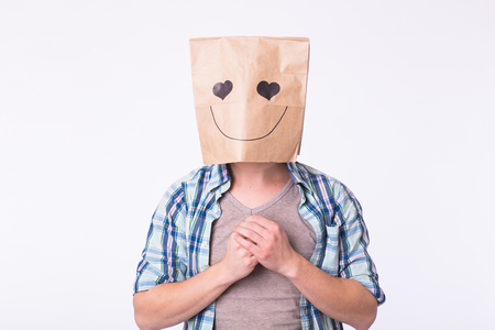 Love, emotion and relationship concept - Man with cardboard box on his head with enamored face.