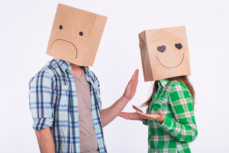 disappointed man with bags over heads rejecting his woman.