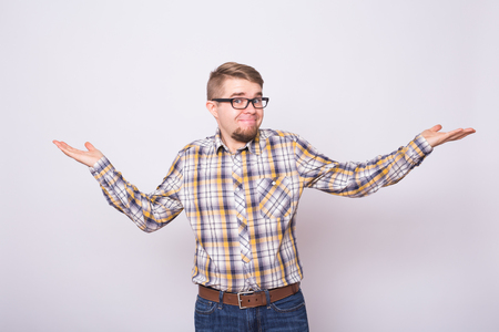 Young emotional surprised, frustrated and bewildered man. Human emotions, facial expression concept on white background. Stock Photo