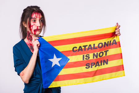 Woman was victim of riots of catalan protesting for spanish government decision about referendum of independence of catalunya Stock Photo