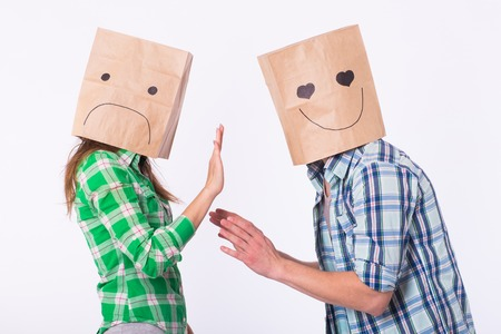disappointed woman with bags over heads rejecting her boyfriend. Banque d'images - 101011878