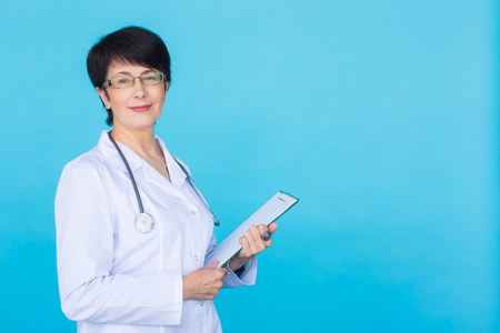 Medical physician doctor woman over blue background with copy space Stock Photo