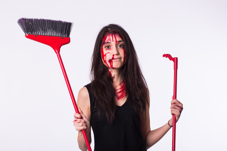The housewife is holding a mop. Young woman standing with blood and bruises on body. Domestic violence, sexual abuse, human trafficking concept Stock Photo