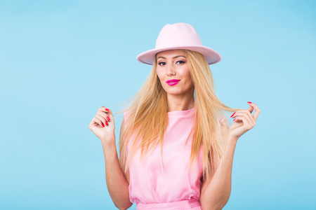 Young woman fashion lookbook model studio portrait on blue background.