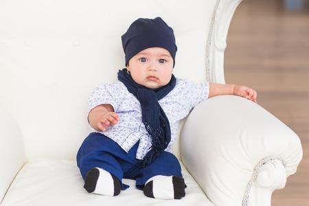 Cute newborn baby boy in sunny room