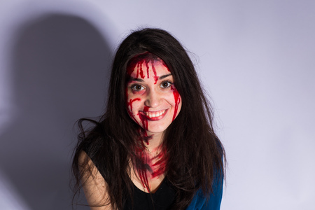 Bloody and scary looking zombie girl. Halloween concept