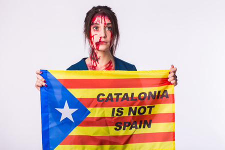 Woman was victim of riots of catalan protesting for spanish government decision about referendum of independence of catalunya Foto de archivo