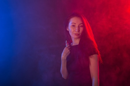 Portrait of asian young woman in red and blue neon smoke