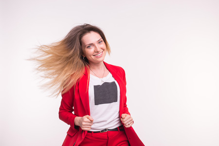 Smiling woman with flying hair on white background with copy space