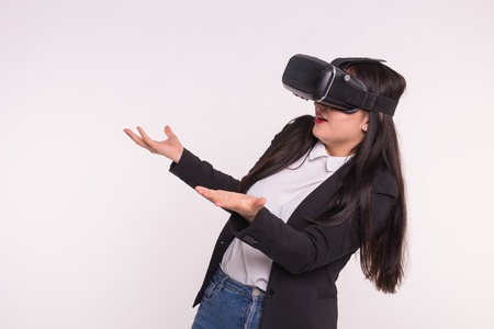 Shocked white girl wearing vr-glasses on white background