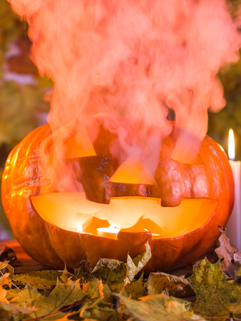 Jack-o-Lantern halloween pumpkin with mist pouring from its mouth Stock Photo