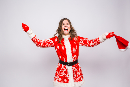 Holiday, Christmas and people concept - Woman in santa costume shouting of joy