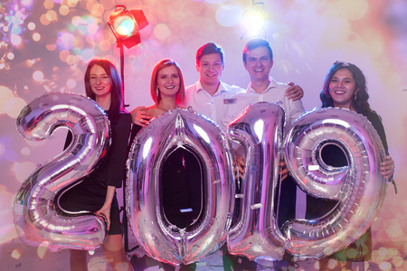 Party, people and new year holidays concept - women and men celebrating new years eve 2019 Stock fotó
