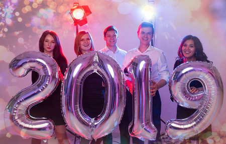 Party, people and new year holidays concept - women and men celebrating new years eve 2019 Stock Photo