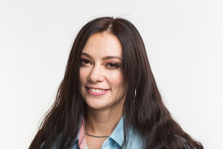 Portrait of beautiful young joyful woman on a white background.