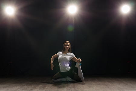 People and dancing concept - Pretty woman dancing jazz funk over dark background