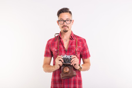 Vintage, photographer and people concept - handsome man with retro camera over white background with copy space Stockfoto