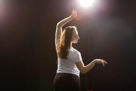 People and street dancing concept - Young fitness woman dancing jazz funk in dance class