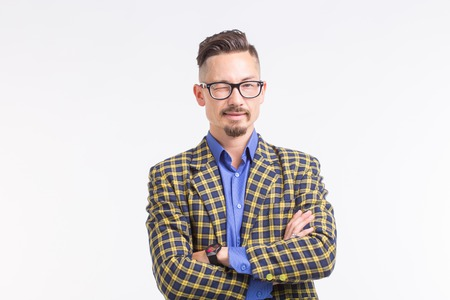 Handsome man in jacket with beard and mustache in glasses having his arms crossed, standing over white background 免版税图像 - 112072615