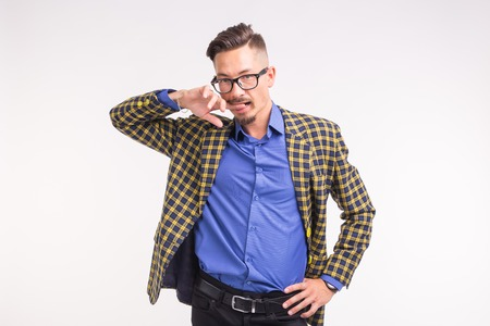 Handsome man in jacket with beard and mustache in glasses having fun over white background