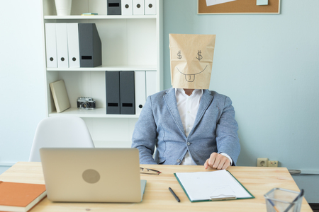 Business, emotions and money concept - office crazy man put a package with painted funny face on her head. Dollar sign in her eyes