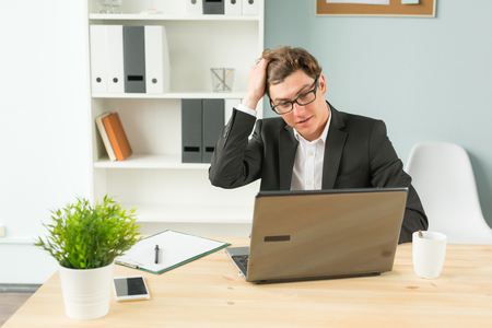 Humor, joke and business people concept - funny man tired after working on computer in office 免版税图像