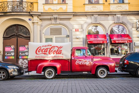 PRAGUE, CZECH REPUBLIC - JUNE 7, 2017: : Red retro car Ford F-100 with advertising inscription Coca Cola on board on the streets of Pragues Old Town