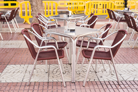 Cafe, coffee shop, tavern and restaurant concept - Outdoor street cafe tables ready for service Banco de Imagens
