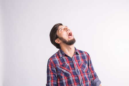 Shocked and surprised face of arab man looking up isolated on white background.