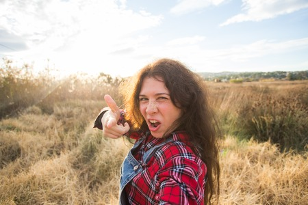 Travel, vacation and holiday concept - Funny young woman taking selfie over beautiful landscape Stock Photo - 116347041