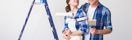 People, redecoration and repair concept - Close up of couple doing renovation in new apartment
