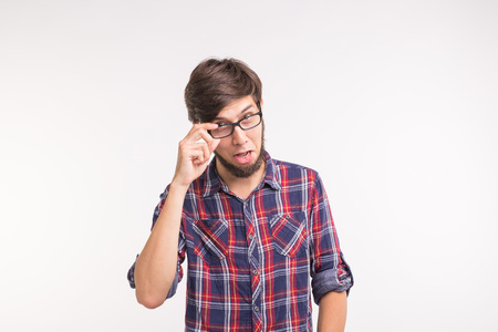 Expression and gesture concept - Surprised man looking at the camera on white background Imagens - 116349794