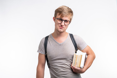 Reading, education, people concept - a young student man holding many books Stok Fotoğraf