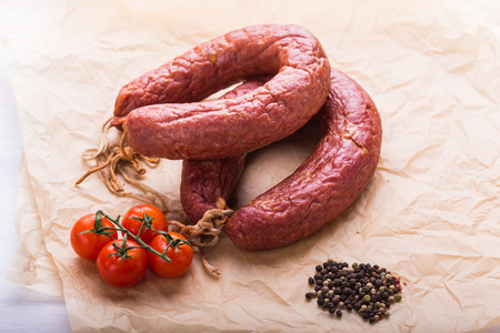 Food concept- Traditional Kazakh horse meat sausage with tomato and pepper
