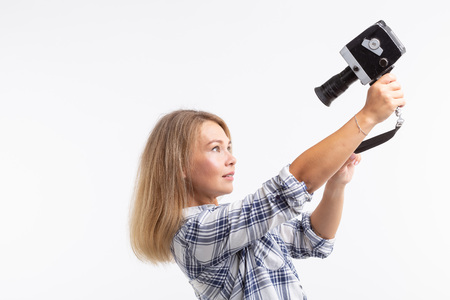 Technologies, photographing and people concept - blonde young woman with retro camera smiling over white background Banque d'images