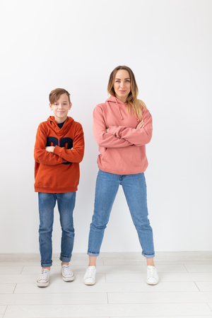 Mothers day, children and family concept - teen boy and his mom posing on white background Banco de Imagens